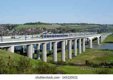 MEDWAY, KENT, ENGLAND - APRIL 30 - A high-speed train traveling across the Medway Viaduct on April 30, 2013 , at Medway Kent. The service offers a high speed alternative for Kent commuters to London.