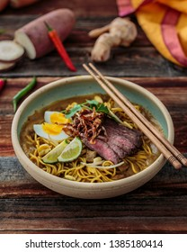 Mee rebus or malaysian boiled noodles in sweet potato gravy