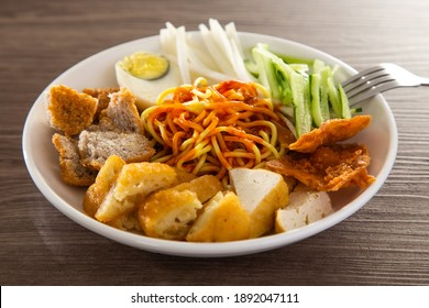 Mee Rojak is Malaysia Indian food of noodle with peanut sauce. One of very famous food in asia.