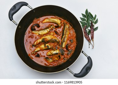 Meen Vattichathu or Pattichathu, sardine fish cooked. Traditional hot and spicy fish curry Kerala India with dried red chilly and green curry leafs. Very popular coastal food eat with tapioca or rice