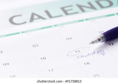meet dentist mark on calendar with a blue pen