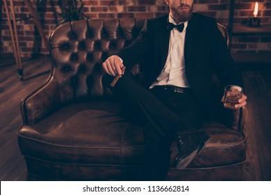Meeting bar restaurant posh rich wealthy rest relax leisure lifestyle weekend look financier concept. Photo of serious virile masculine successful powerful elegant handsome economist sitting on divan