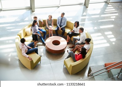 Meeting in a business lounge area, elevated view