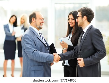 meeting business partners in the office before presentation