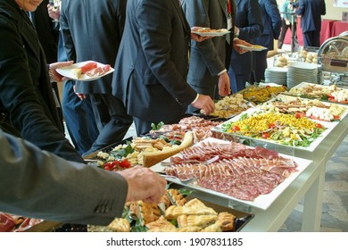 meeting of business people during the buffet, self service with different types of food