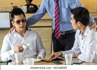 Meeting businessman in coffee shop
