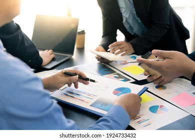 Meeting concept Business team hands at working with financial plan, meeting, discussion, brainstorm with tablet on the office desk,