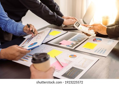 Meeting Concept Close up hands of a young businesswoman pointing to sale chart in a paper report on the table for brainstorming and discussion in meeting day, Business startup