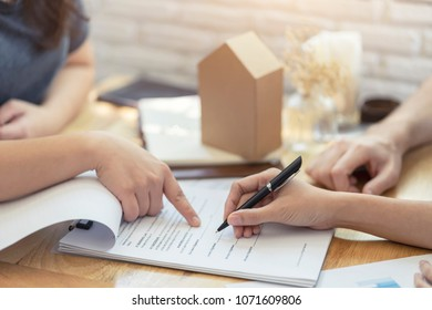 Meeting concept, Woman putting signature on document contract, real estate purchase, success business contract deals with sale represent.