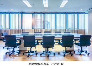 Meeting and conference room with wide glass windows in an office. It is on modern high rise building.