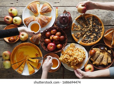 Meeting friends at the festive table to celebrate the Passover.The view from the top,the guest hands over the food table.Close up.