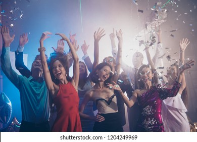 Meeting, gathering, corporate, feast, festive mood concept. Crowd of friends raised hands up, make big smile, close eyes and dance