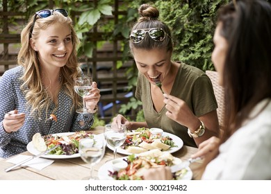 Meeting of girls at the fashion restaurant