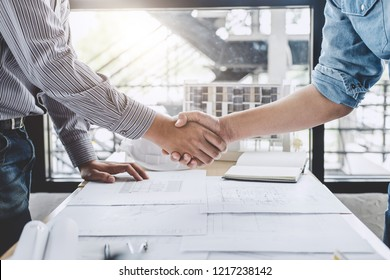 Meeting and greeting, Two engineer or architect meeting for project, handshake after consultation and conference new project plan, contract for both companies, success, partnership.