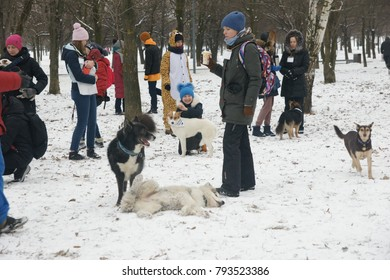 Meeting hosts of dogs taken from the shelter. Moscow, Russia, January 14, 2018.