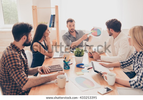at a meeting manager showing document to his worker