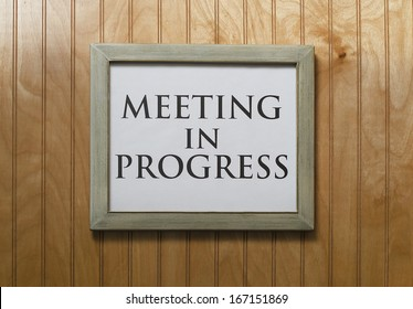 meeting in progress sign on wall
