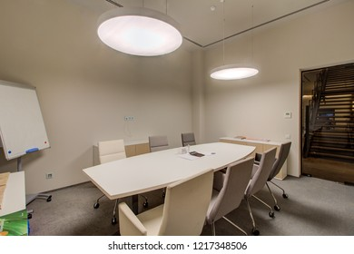 Meeting room with big table and projector. Modern conference hall with furniture in office. Moscow - 2018