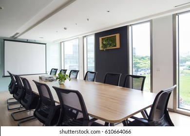 Meeting room with big table and projector