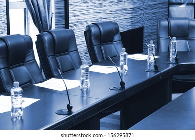 Meeting room in office center in shades of grey