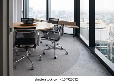 Meeting room professional board room lit by natural light chairs and table modern office fitout