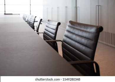 Meeting room professional board room lit by natural light chairs and table