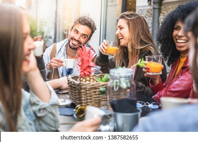 meeting of schoolmates having fun together on an outdoors cafeteria. Boys and girls joking together lifestyle concept.
