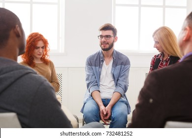 Meeting of support group. Happy man talking about his life, everything good. Mental health, psychotherapy concept