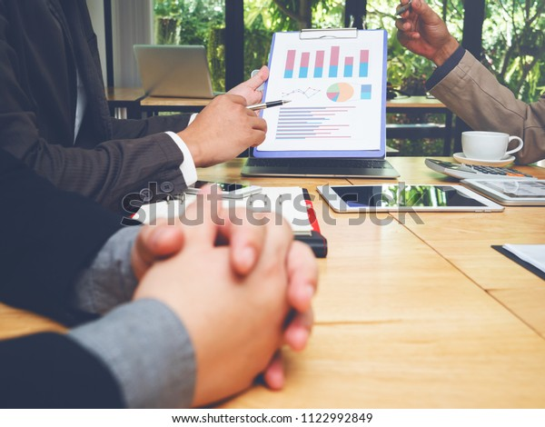 Meeting of tax lawyer business man and company president to discuss the problem of taxation on SMEs, teamwork, working together concept.