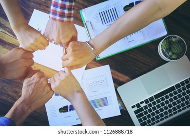 Meeting teamwork concept,Friendship,Group people with stack of hands showing unity after successful negotiations at office