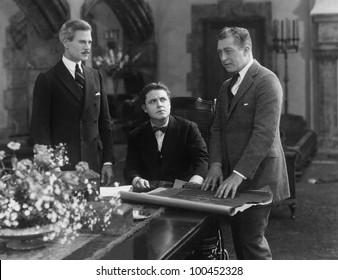 Meeting of three businessmen