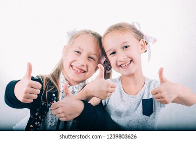 meeting of two girlfriends emotions going wild, girls on white background