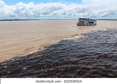 Meeting of the Waters of Rio Negro and the Amazon River or Rio Solimoes near Manaus, Amazonas, Brazil in South America