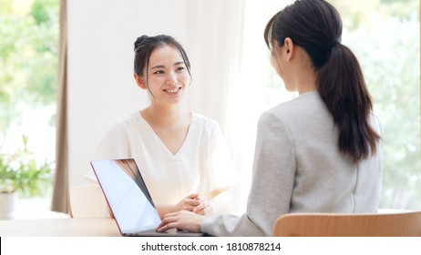Meeting young asian women in the room. Consultant. - Shutterstock ID 1810878214
