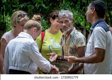 Meetiyagoda, Sri Lanka, 31 May 2016: A Sri Lankan worker shows tourists the precious moonstones extracted just from the mine.