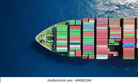 Mega container ship at sea - Top down aerial view