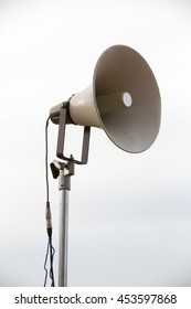mega phone on a metal pole is an annoucement equipment