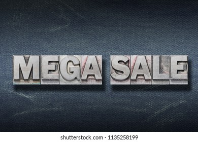 mega sale made from metallic letterpress on dark jeans background