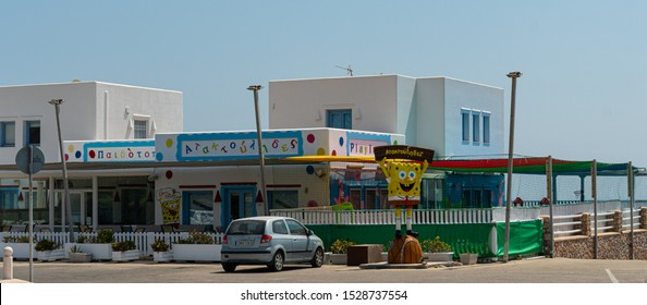 Megalochori, Greece - July 17 2019:   Playland childrens play centre with a Spongebob Squarepants statue outside along the Fira to Perissa road