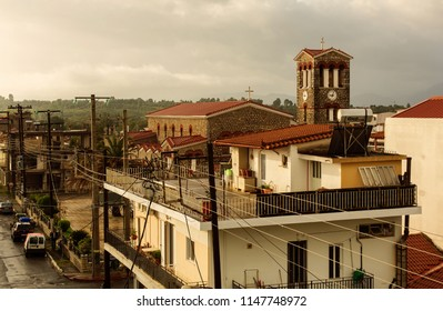 MEGALOPOLI, GREECE - OCTOBER 11, 2015: Top view of a house and the Ekklisia Agios Nikolaos Church in the town of Megalopoli in the morning, Peloponnese, Greece