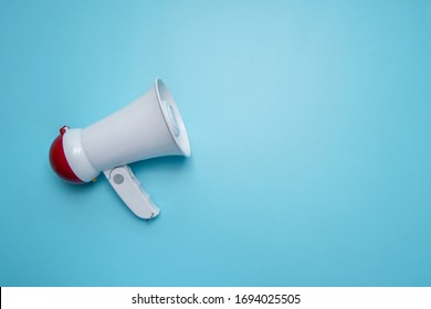 Megaphone announcement on blue background with copy space