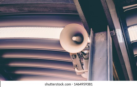 Megaphone announcing important information. The concept of providing information to people. Announcement of trains, information about problems, inconveniences.