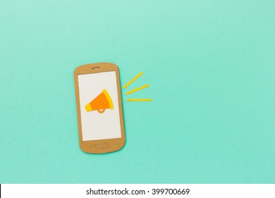Megaphone on smart phone - mobile marketing and advertising concept with space for text