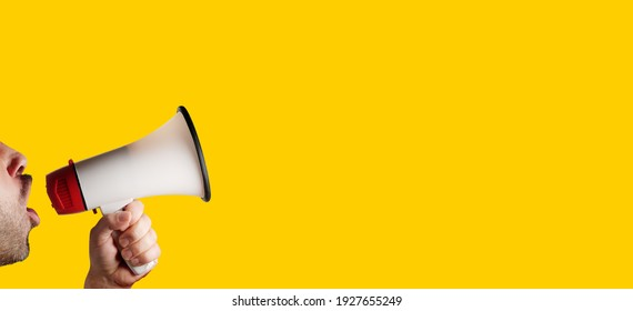 megaphone speaking announcing against isolated on yellow solid background