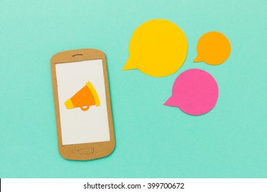 Megaphone and speech bubbles on mobile phones