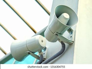 Megaphone, two loudspeakers on the wall.