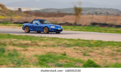 """MEGARA, GREECE, MARCH 8, 2020. Panning shot of japanese sports car MAZDA MX5, during """"TRACK DAY-PHILPA 2020"""" event at Megara circuit close to Athens."""
