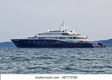 Megayacht floating on open sea, side view