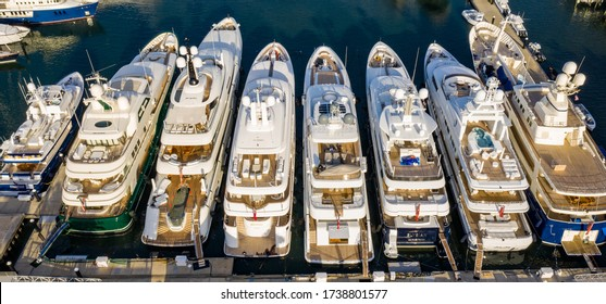 Megayachts secured to the dock in Palm Beach Florida
