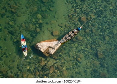 Meghalaya 11 March, 2020 : Top view showing crystal clear emerarld green waters of River Umngot with fishing boats in Shnongpdeng village,  Meghalaya, North East, India,Asia